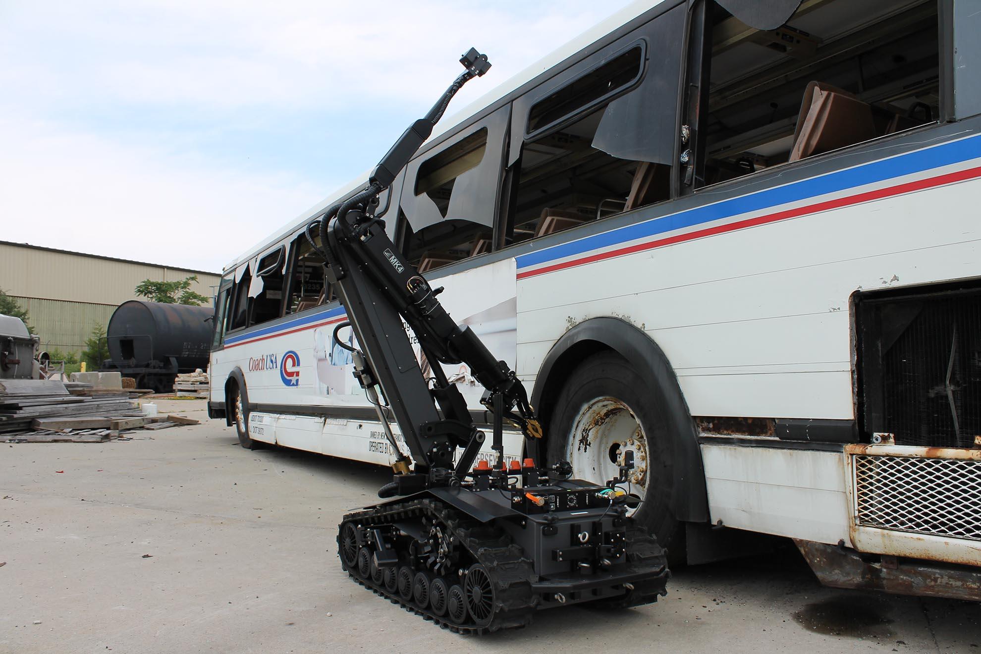 caliber-mk4-lvbied-robot-inspecting-bus